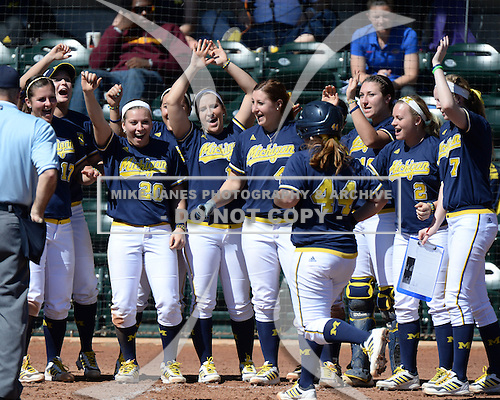 Michigan Wolverines Softball infielder Caitlin Blanchard (44) comes home after hitting a home run during a game against the Bethune-Cookman on February 9, 2014 at the USF Softball Stadium in Tampa, Florida.  Michigan defeated Bethune-Cookman 12-1.  (Copyright Mike Janes Photography)