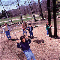 Children playing on swings<br />