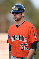 Aberdeen IronBirds hitting coach Scott Thomas (22) during a game against the Williamsport Crosscutters on August 4, 2014 at Bowman Field in Williamsport, Pennsylvania.  Aberdeen defeated Williamsport 6-3.  (Mike Janes/Four Seam Images)
