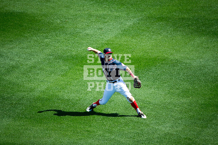 Washington Nationals outfielder Bryce Harper (34) throws a ball in from the outfield during a game against the Miami Marlins at Nationals Park in Washington, DC on September 9, 2012.