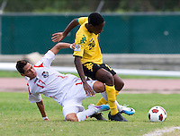 Shawn-Claud Lawson (20) of Jamaica is tackled by Bryan Santamaria (17) of Panama during the third place game of the CONCACAF Men's Under 17 Championship at Catherine Hall Stadium in Montego Bay, Jamaica. Panama defeated Jamaica, 1-0.