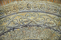 Geometric relief decoration around the south proch of the 12the century early transitional Norman architecture of the parish church of St Peter & St Paul part of Malmesbury Abbey, Wiltshire, England
