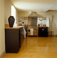 In this Normandy kitchen clutter has been kept to the barest minimum resulting in a pleasing atmosphere of light and space