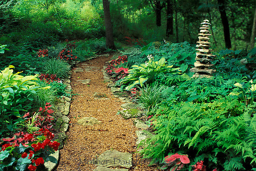 Handmade Cairn in shade Garden-- It is much more stable than it looks, Midwest USA