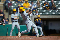 Tevin Tucker (2) of the West Virginia Mountaineers follows through on his swing against the Illinois Fighting Illini at TicketReturn.com Field at Pelicans Ballpark on February 23, 2020 in Myrtle Beach, South Carolina. The Fighting Illini defeated the Mountaineers 2-1.  (Brian Westerholt/Four Seam Images)