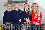 The new junior infants stand with their teacher Máire Collins in Knocknagoshel NS on Thursday.