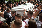 """© Joel Goodman - 07973 332324 . 28/08/2015 . Salford , UK . Paul Massey's coffin is carried in to the church as the crowd applauds . The funeral of Paul Massey at St Paul's CE Church in Salford . Massey , known as Salford's """" Mr Big """" , was shot dead at his home in Salford last month . Photo credit : Joel Goodman"""