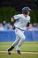 Staten Island Yankees shortstop Angel Aguilar (12) runs to first during a game against the Batavia Muckdogs on August 27, 2016 at Dwyer Stadium in Batavia, New York.  Staten Island defeated Batavia 13-10 in eleven innings.  (Mike Janes/Four Seam Images)
