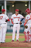 Harrisburg Senators first baseman Jose Marmolejos (3), catcher Raudy Read and Drew Ward (17) on the mound for a pitching change during a game against the Bowie Baysox on May 16, 2017 at FNB Field in Harrisburg, Pennsylvania.  Bowie defeated Harrisburg 6-4.  (Mike Janes/Four Seam Images)