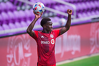 ORLANDO, FL - APRIL 24: Richie Laryea #22 of Toronto FC throws the ball in during a game between Vancouver Whitecaps and Toronto FC at Exploria Stadium on April 24, 2021 in Orlando, Florida.