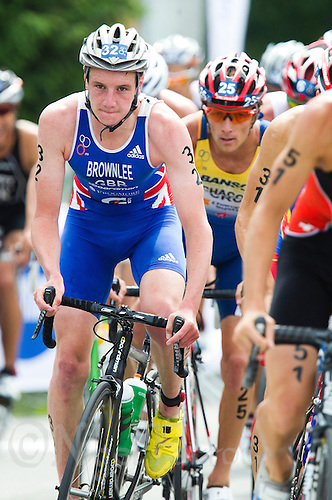 24 JUN 2012 - KITZBUEHEL, AUT - Alistair Brownlee (GBR) of Great Britain (left, in blue and white) rides in the lead pack on the bike during the elite men's 2012 World Triathlon Series round in Schwarzsee, Kitzbuehel, Austria (PHOTO (C) 2012 NIGEL FARROW)