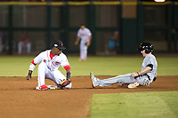 Scottsdale Scorpions second baseman Shed Long (6), of the Cincinnati Reds organization, prepares to apply the tag to Brian Miller (10), of the Miami Marlins organization, as he slides into second base on a stolen base attempt during an Arizona Fall League game against the Salt River Rafters at Scottsdale Stadium on October 12, 2018 in Scottsdale, Arizona. Scottsdale defeated Salt River 6-2. (Zachary Lucy/Four Seam Images)