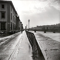 Biking along river in Florence<br />