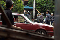 A police patrol in downtown Yangon aim their guns up at apartments where they suspect protesters may be hiding, on the 12th day of protests calling for the overthrow of the country's military junta. A violent crackdown by the authorities had successfully halted most of the demonstrations.