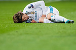Luka Modric of Real Madrid lies injured on the pitch during the UEFA Champions League 2017-18 Round of 16 (1st leg) match between Real Madrid vs Paris Saint Germain at Estadio Santiago Bernabeu on February 14 2018 in Madrid, Spain. Photo by Diego Souto / Power Sport Images