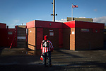 Witton Albion 1 Warrington Town 2, 26/12/2017. Wincham Park, Northern Premier League. A solitary home supporter waiting outside a turnstile Wincham Park, home of Witton Albion before their Northern Premier League premier division fixture with Warrington Town. Formed in 1887, the home team have played at their current ground since 1989 having relocated from the Central Ground in Northwich. With both team chasing play-off spots, the visitors emerged with a 2-1 victory, the winner being scored by Tony Gray in second half injury time, watched by a crowd of 503. Photo by Colin McPherson.