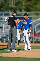 Danville Braves manager Robinson Cancel (38) discusses a call with umpire Dillon Wilson during the game against the Kingsport Mets at American Legion Post 325 Field on July 9, 2016 in Danville, Virginia.  The Mets defeated the Braves 10-8.  (Brian Westerholt/Four Seam Images)