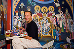 Iconographer Miloje Milinkovic paints icons and frescos on the wall of historic St. Sava Orthodox Church, Jackson, Calif.