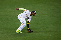 Pittsburgh Pirates outfielder Andrew McCutchen fields a ground ball during the MLB All-Star Game on July 14, 2015 at Great American Ball Park in Cincinnati, Ohio.  (Mike Janes/Four Seam Images)