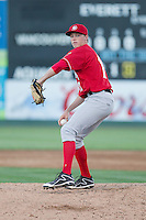 Josh DeGraaf (12) of the Vancouver Canadians delivers a pitch during a game against the Everett Aquasox at Everett Memorial Stadium in Everett, Washington on July 27, 2015.  Everett defeated Vancouver 6-0. (Ronnie Allen/Four Seam Images)