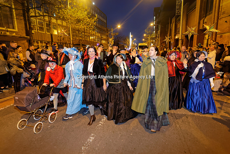 """Pictured: Actress Michelle McTernan (with black jacket) with locals dressed as festive characters lead the Christmas parade in Swansea, Wales, UK. Sunday 19 November 2018<br /> Re: Swansea Christmas parade attended by thousands has been branded a """"shambles"""" for having just three floats.<br /> The annual festive event in south Wales, which took place on Sunday, promised """"dynamic dance-troupes"""" as well as """"spectacular shows and stages"""".<br /> But the parade was scaled down, leading to a barrage of criticism on social media because of roadworks in the city centre. <br /> The leader of Swansea Council, Rob Stewart apologised on Facebook and said the parade was not """"good enough"""".<br /> Parents took on social media to voice their anger, calling the event """"a load of rubbish"""" and claiming there was nothing for young children apart from """"a loud music float with Santa on""""."""