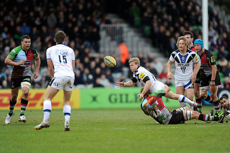 Michael Classens of Bath Rugby passes as he is tackled by Chris Robshaw of Harlequins during the Aviva Premiership match between Harlequins and Bath Rugby at the Twickenham Stoop on Saturday 13th April 2013 (Photo by Rob Munro)