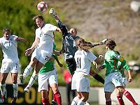 Abby Wamback tries to beat Mexico's goalkeeper, Pamela Tajonar, for a headball..USA 3-0 over Mexico in San Diego, California, Sunday, March 28, 2010.