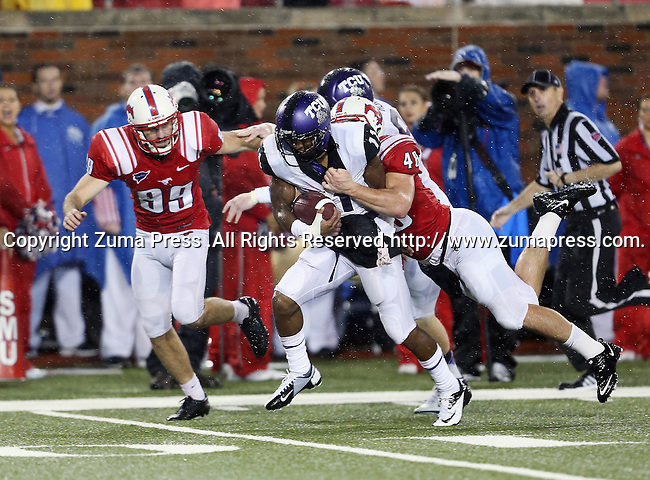 TCU Horned Frogs wide receiver Skye Dawson (11)  and Southern Methodist Mustangs running back Zach Line (48) in action during the game between the Southern Methodist Mustangs and the TCU Horned Frogs at the Gerald J. Ford Stadium in Dallas, Texas. TCU leads SMU 21 to 10 at halftime..