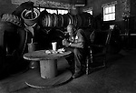 """AOF.FE.080205.EDR.JPG   """"Gracious Lord, thank you for this food,"""" whispered Rufus Mitchell, saying grace over lunch in his garage at Nu Tread Tire Co. in Durham where he has repaired truck tires for nearly 30 years.  After replacing seven tires on Tuesday morning, Aug. 2, 2005, Mitchell clocked out for his 1-hour lunch break, scrubbed his hands with a tire brush and sat down to a relative feast of fried chicken, bread and sweet tea.  """"I don't have money all the time, and sometimes it's just nabs and a soda,"""" Mitchell said, """"but I always take time to thank God for meeting my needs.""""  staff/Ted Richardson."""
