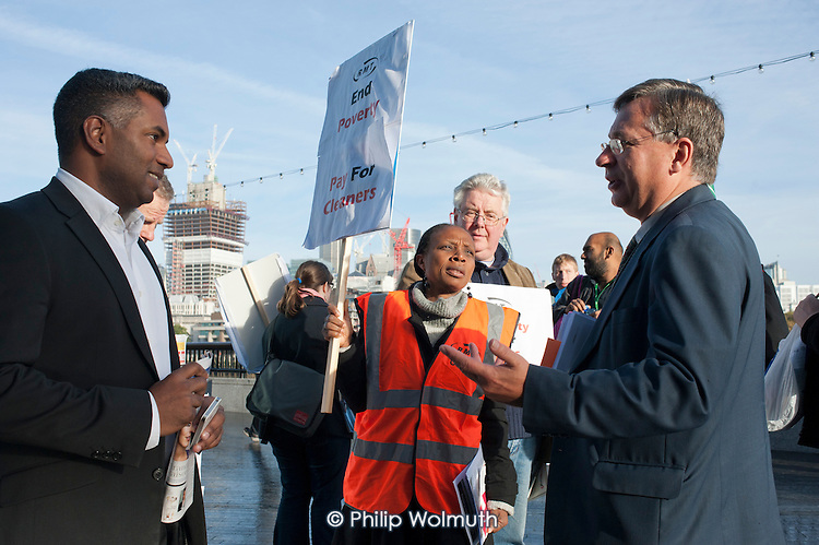 RMT tube cleaners demonstrating for a Living Wage speak to Labour group members outside the Greater London Assembly.