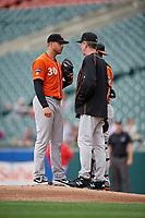 Norfolk Tides pitching coach Mike Griffin talks with pitcher Jay Flaa (30) during an International League game against the Buffalo Bisons on June 21, 2019 at Sahlen Field in Buffalo, New York.  Buffalo defeated Norfolk 2-1, the first game of a doubleheader.  (Mike Janes/Four Seam Images)