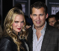 """HOLLYWOOD, CA - NOVEMBER 03: Model/Actress Molly Sims and her husband Scott Stuber arrive at the Los Angeles Premiere Of DreamWorks Pictures' """"Delivery Man"""" held at the El Capitan Theatre on November 3, 2013 in Hollywood, California. (Photo by Xavier Collin/Celebrity Monitor)"""
