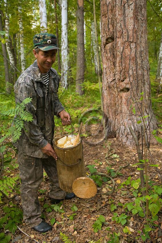 Issangugin Sentimir with his Batman jar full of 8 kg of honey.