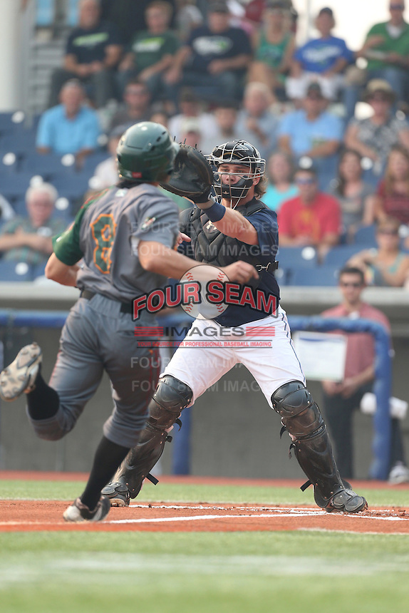 Stryker Trahan (40) of the Hillsboro Hops waits for the ball before tagging out Brian Carroll (8) of the Boise Hawks at home plate during a game at Ron Tonkin Field on August 22, 2015 in Hillsboro, Oregon. Boise defeated Hillsboro, 6-4. (Larry Goren/Four Seam Images)