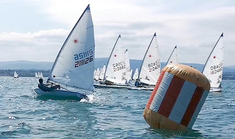 Jack Fahy port tacks the Radial fleet at the Dublin Bay Laser 50th anniversary event for the second time in a row!
