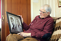 Pictured: Franco Gorno holding framed pictures of himself and late wife Joan at his house in Cardiff, south Wales. Tuesday 25 March 2014<br />