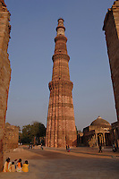 The tower Qutub Minar built of red sandstone is the tallest brick minaret in the world, and an important example of Indo-Islamic Architecture. The tower is in the Qutb complex at Mehrauli in South Delhi, India, India.