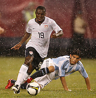 United States midfielder Freddy Adu (19) gets past a tackle by Argentina midfielder Éver Banega (15). The men's national teams of the United States and Argentina played to a 0-0 tie during an international friendly at Giants Stadium in East Rutherford, NJ, on June 8, 2008.