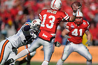 01 January 2007: Nebraska quarterback Zac Taylor (#13) unleashes a pass before he is hit hard by an Auburn defender Marquies Gunnn (#48) during the 2007 AT&T Cotton Bowl Classic between The University of Auburn and The University of Nebraska at The Cotton Bowl in Dallas, TX.