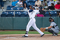 Phillips Castillo #17 of the Everett AquaSox at bat during a game against the Tri-City Dust Devils at Everett Memorial Stadium in Everett, Washington on July 28, 2014. Tri-City defeated Everett 6-5 in 11 innings.  (Ronnie Allen/Four Seam Images)