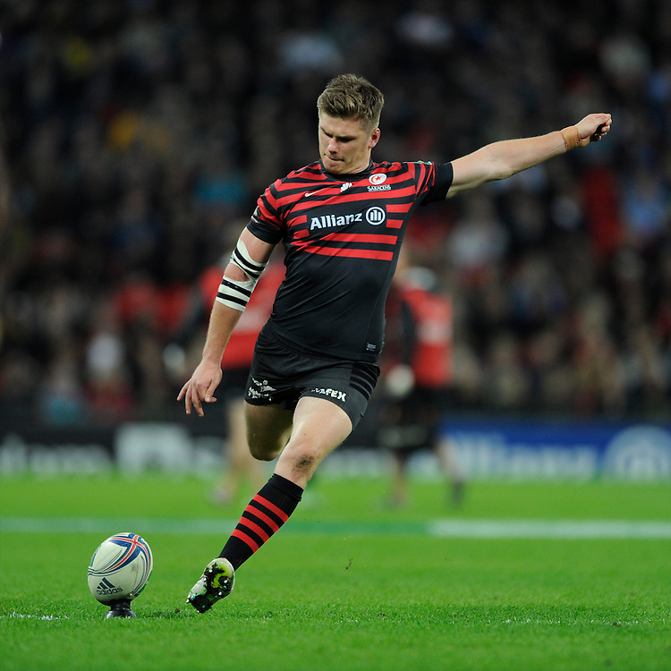 20131018 Copyright onEdition 2013©<br /> Free for editorial use image, please credit: onEdition<br /> <br /> Owen Farrell of Saracens takes a kick during the Heineken Cup match between Saracens and Stade Toulousain at Wembley Stadium on Friday 18th October 2013 (Photo by Rob Munro)<br /> <br /> For press contacts contact: Sam Feasey at brandRapport on M: +44 (0)7717 757114 E: SFeasey@brand-rapport.com<br /> <br /> If you require a higher resolution image or you have any other onEdition photographic enquiries, please contact onEdition on 0845 900 2 900 or email info@onEdition.com<br /> This image is copyright onEdition 2013©.<br /> This image has been supplied by onEdition and must be credited onEdition. The author is asserting his full Moral rights in relation to the publication of this image. Rights for onward transmission of any image or file is not granted or implied. Changing or deleting Copyright information is illegal as specified in the Copyright, Design and Patents Act 1988. If you are in any way unsure of your right to publish this image please contact onEdition on 0845 900 2 900 or email info@onEdition.com
