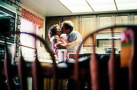 Steve Nelson and Phyllis Nelson kissing in the kitchen, 1987.   &#xA;<br />