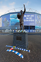 Pictured: Scarves and tributes left by the statue of Frederick Charles Keenor outside the Cardiff City Stadium in south Wales, UK. Tuesday 22 January 2019<br /> Re: Premier League footballer Emiliano Sala was on a flight which disappeared between France and Cardiff.<br /> The Argentine striker was one of two people on board the Piper Malibu, which disappeared off Alderney on Monday night.<br /> Cardiff City FC, signed the 28-year-old from French club Nantes.<br /> A search is under way.<br /> A Cardiff Airport spokeswoman confirmed the aircraft was due to arrive from Nantes but said there were no further details.<br /> HM Coastguard has sent two helicopters to help.
