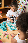 Education Preschool Phase-in First Days of School 2-3 year olds play dough activity child putting balls of play dough in to depressions on container