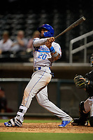 Tennessee Smokies right fielder Eddy Martinez (20) follows through on a swing during a game against the Birmingham Barons on August 16, 2018 at Regions FIeld in Birmingham, Alabama.  Tennessee defeated Birmingham 11-1.  (Mike Janes/Four Seam Images)