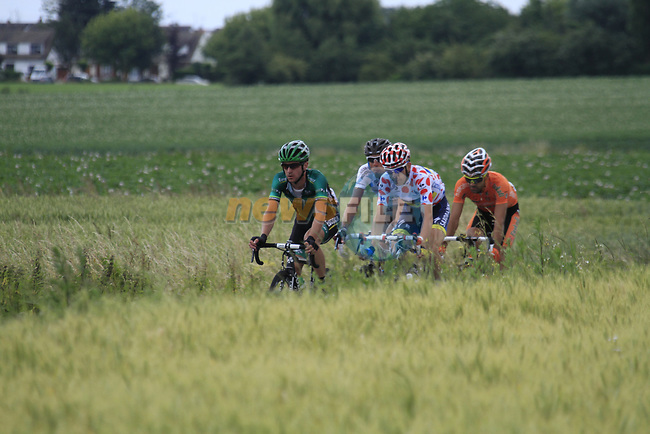 The breakaway group including Polka Dot Jersey wearer Michael Morkov (DEN) Saxo Bank-Tinkoff Bank, Giovanni Bernaudeau (FRA) Team Europcar, Ruben Perez Moreno (ESP) Euskaltel-Eskadi and Sebastien Minard (FRA) AG2R La Mondiale pass near the village of Aubers during Stage 3 of the 99th edition of the Tour de France 2012, running 197km from Orchies to Boulogne-sur-Mere, France. 3rd July 2012.<br /> (Photo by Eoin Clarke/NEWSFILE)