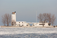 The abandoned Coast Guard Station on Whiskey Island on a cold winter day.  The station,  located at the entrance of the Cuyahoga River into Cleveland Harbor, was vacated by the Coast Guard in 1976.