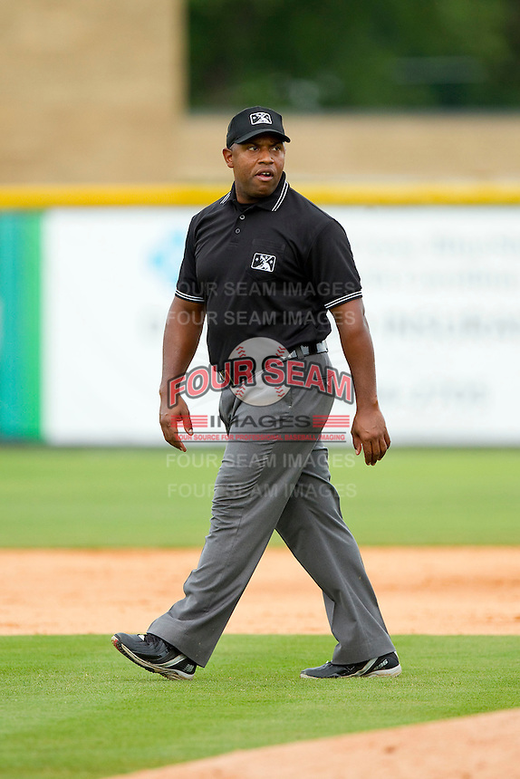 Umpire Brad Polk handles the calls on the bases during the Appalachian League game between the Greeneville Astros and the Burlington Royals at Burlington Athletic Park on July 1, 2013 in Burlington, North Carolina.  The Astros defeated the Royals 7-0 in Game One of a doubleheader.  (Brian Westerholt/Four Seam Images)
