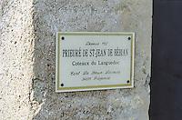 A sign on a stone pillar at Prieure de St-Jean de Bebian, Coteaux du Languedoc, Pezenas, owned by Le Brun-Lecouty. Founded in 1152 , Languedoc-Roussillon, France