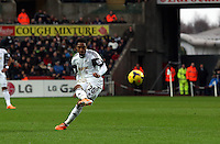 Wednesday, 01 January 2014<br /> Pictured: Jonathan de Guzman of Swansea takes a shot off target.<br /> Re: Barclay's Premier League, Swansea City FC v Manchester City at the Liberty Stadium, south Wales.